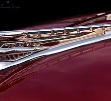 Naked flying lady hood ornament by Jeffrey  Sinnock