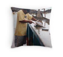 Cleaning fish, Puerto Aroyo, Galapagos Islands Throw Pillow