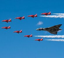 Avro Vulcan and Red Arrows by Christopher  Bates