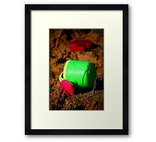 Toys on the beach Framed Print