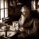 Trade - Tin Smith - Making toys for Children - BW by Mike  Savad