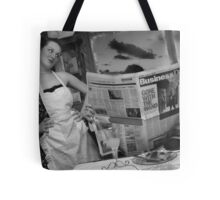Reading the paper Tote Bag