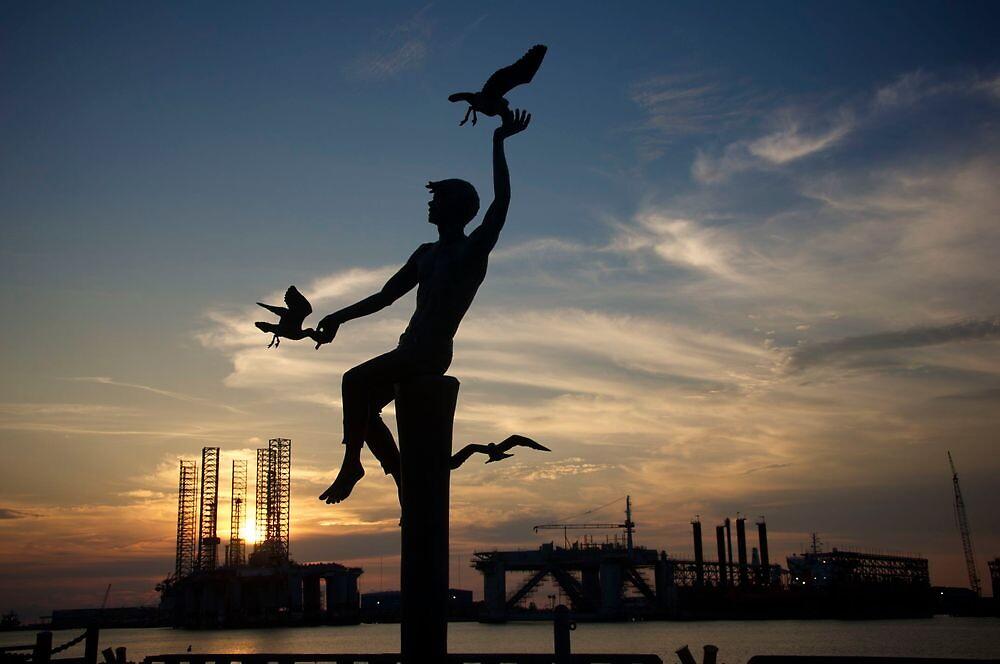 Boy with seagulls statue - Pier 21 Galveston, TX by Ann Reece