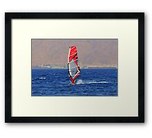 Windsurfing in a red sea Framed Print