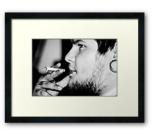 He likes to smoke Framed Print
