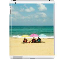 Three umbrella on a lonely sea beach iPad Case/Skin