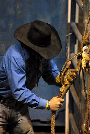 A Professional Bull Rider preps his bull rope by ElfinYeti