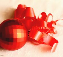 Red geodesic Christmas ball with red ribbon  on white damask linen by pogomcl