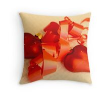 Two red satin glass hearts with red ribbon on a white cotton mat Throw Pillow