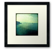 you are somewhere by a different sea and I am here... Framed Print