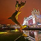 Dolphin playing in the Limelight - Tower Bridge in London by DavidGutierrez