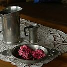 Pewter and faded roses by Gilberte