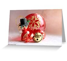 Miniature snowman, red Christmas ball and jingle bell with curled red and gold ribbon Greeting Card