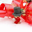 Snowman with red Christmas ball on snow by pogomcl