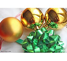 Three gold Christmas balls with green ribbon Photographic Print