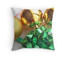 Three gold Christmas balls with green ribbon Throw Pillow