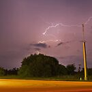 Stormy highway by Larry  Grayam
