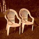 Two Lonely White Chairs by Katie Woodcock