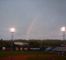 Rainbow during baseball game by RaeLouise