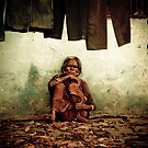 Taking a moment... - Varanasi, India by Marlies van Kampen