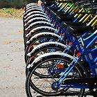 Wheels on Row of Bikes  by jojobob