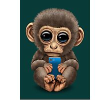 Cute Baby Monkey Holding a Blue Cell Phone  Photographic Print