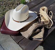 Cowboy Tools of the trade - a good hat, good pair of gloves,some rope and the manual. by Rick Short