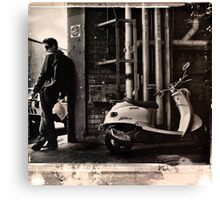 He had the jacket and the pose but he knew his Jx50 Milan wasn't a 1961 Triumph TR6 Trophy and he'd never escape his boring life. Steve McQueen must be turning in his grave. Canvas Print