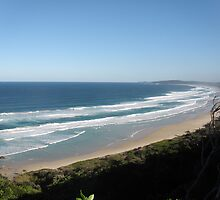 A crowded beach at Byron bay NSW. by Alex Gardiner