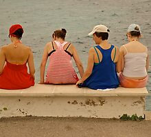 4 women sitting by the sea. by Mike  Waldron