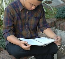 reading a book by bayu harsa