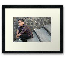 siting down Framed Print