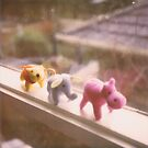 walking the ledge - plush animals on a windowsill path by brenda mangalore