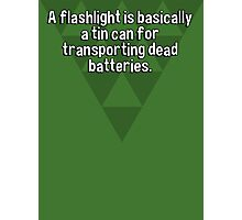A flashlight is basically a tin can for transporting dead batteries. Photographic Print