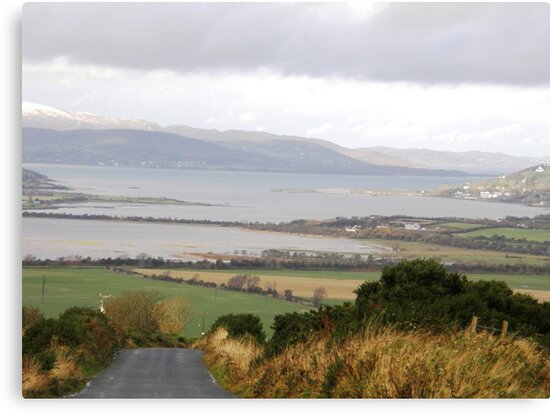Lough Swilly with snow capped Donegal Hills - Donegal Ireland  by mikequigley