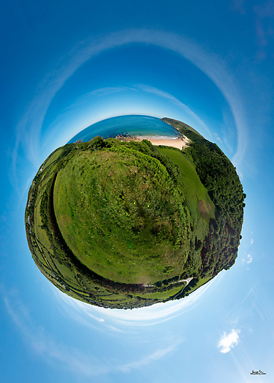 Kinnagoe Bay (as a floating green planet) by George Row