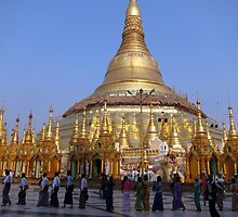 Sunset procession at Shewdagon pagodo - Yangon, Myanmar by John Kleywegt