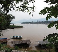 Ruak meets Mekong river at Golden Triangle, Thailand by John Kleywegt