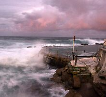 Bronte rockpool stormy sunset by Mike Orchard