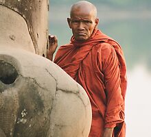 Monk at Angkor Wat by Andre Rickerby