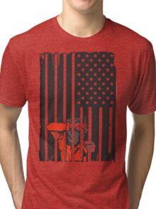 Guantanamo US Flag Political T-shirt. Prisoner behind bars. Tri-blend T-Shirt