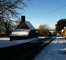 English village in the sun and snow. by Kathy Dellow