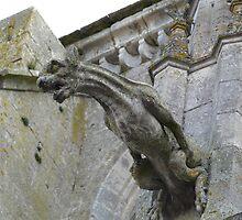 Gargoyle at guard, St Thibault, France by Kiriel