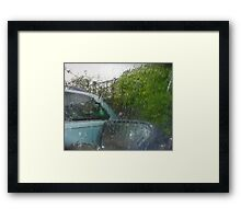 Waiting For A Lull In The Rain Framed Print