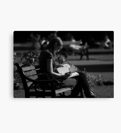 Reading in the Park Canvas Print