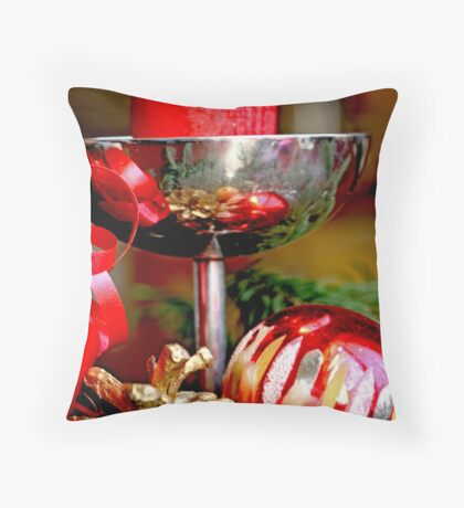 Red candle and Christmas ornaments  A Throw Pillow
