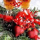 Two fluted wineglasses  stand amongst yew with two crimson  hearts A by pogomcl