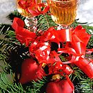 Two fluted wineglasses  stand amongst yew with two crimson  hearts C by pogomcl