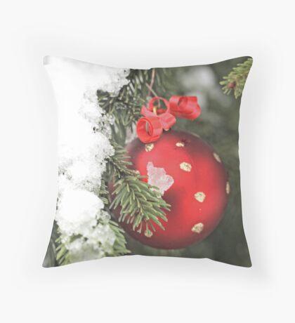 Red Christmas ball on snowy fir Throw Pillow