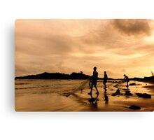fishermen on the beach Canvas Print